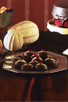 Крофна holes transform into a Halloween party dessert with a quick dip in melted chocolate and an M&M garnish.Recipe: Chocolate Eyeballs