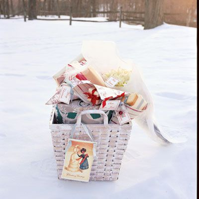 Malutki gifts tucked inside paper cones, each with its own handcrafted gift tag attached, fill a woven basket to overflowing and await parceling out to friends and family. Learn here how to craft these easy projects yourself. All can be done in a weekend.