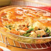 Pui and vegetables are paired in a creamy sauce made with Campbell's Condensed Cream of Chicken Soup and topped with a golden biscuit crust.