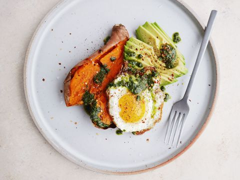 loaded Baked Sweet Potatoes with Avocado, Pesto, and Fried Eggs Horizontal